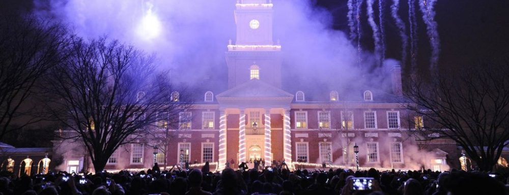 Exterior night scene of Gilman Hall, during the winter festival.