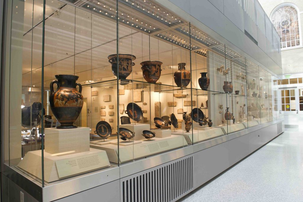 Greek bowls and urns on display in Mason Hall.